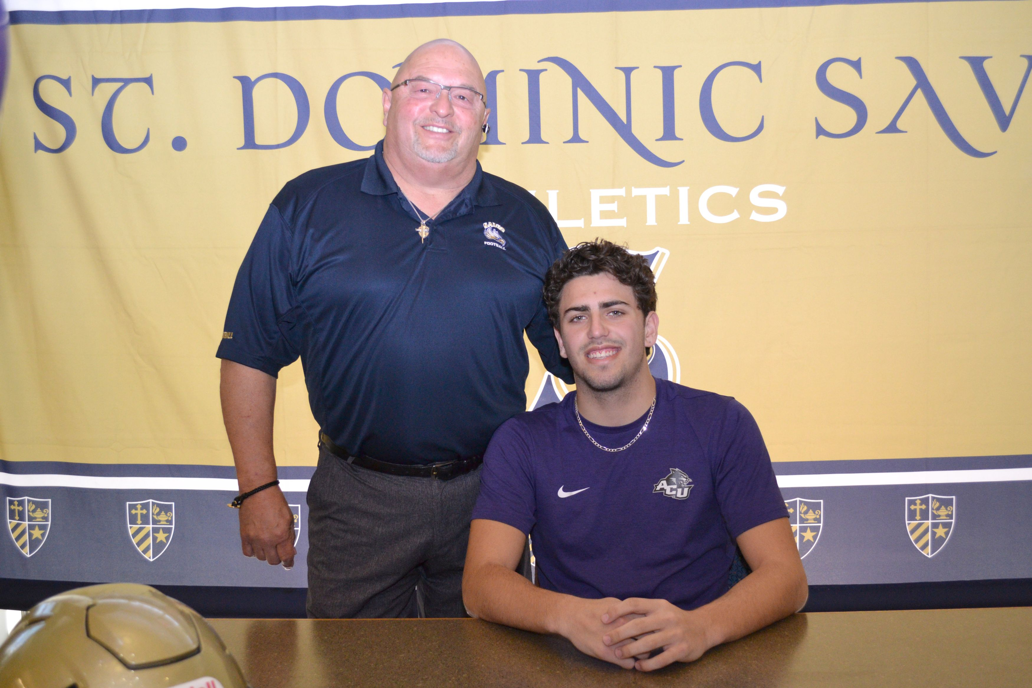 Student Signs To Play Football In The Fall